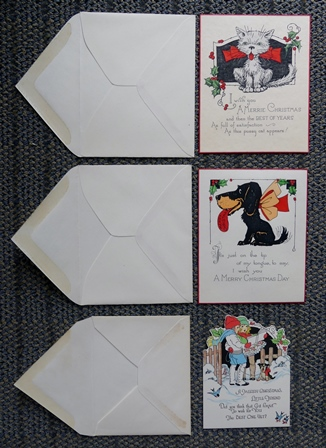 Image for 3 VINTAGE CHRISTMAS CARDS - 1. CAT.  2. DOG.  3. CHILDREN CAROLLING.  WITH ORIGINAL ENVELOPES.